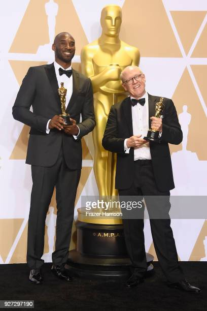 Filmmakers Kobe Bryant and Glen Keane, winners of the Best Animated Short Film award for 'Dear Basketball,' pose in the press room during the 90th...