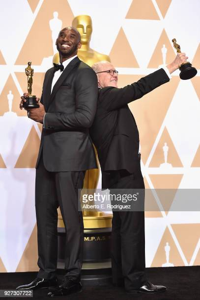 Filmmakers Kobe Bryant and Glen Keane, winners of the Best Animated Short Film award for 'Dear Basketball,' poses in the press room during the 90th...