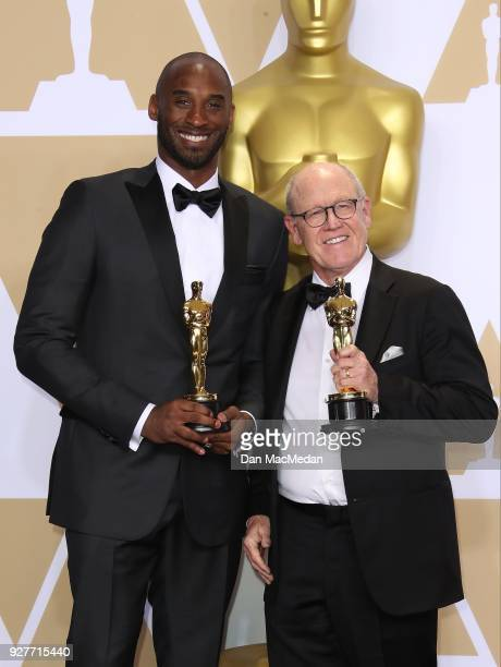 Filmmakers Kobe Bryant and Glen Keane, winners of the Best Animated Short Film award for 'Dear Basketball,' pose in the press room at the 90th Annual...