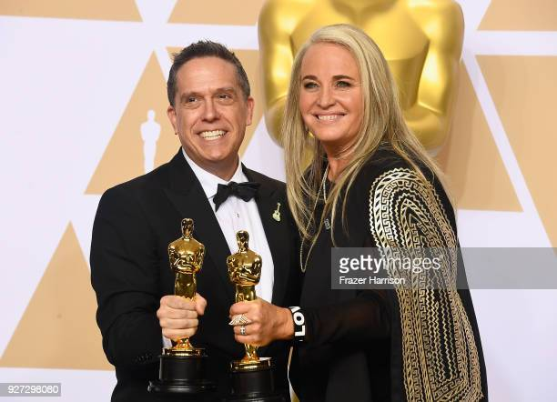 Filmmakers Lee Unkrich and Darla K Anderson winners of the Best Animated Feature Film for 'Coco' pose in the press room during the 90th Annual...
