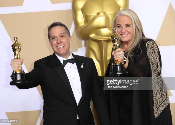 Filmmakers Lee Unkrich and Darla K Anderson winners of the Best Animated Feature Film for 'Coco' pose in the press room at the 90th Annual Academy...