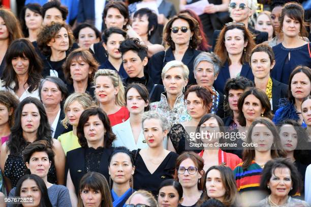 Filmmakers listen as Jury head Cate Blanchett reads a statement on the steps of the red carpet in protest of the lack of female filmmakers honored...