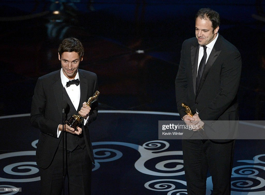 Filmmakers Malik Bendjelloul and Simon Chinn accept the Best Documentary - Feature award for 'Searching for Sugar Man' onstage during the Oscars held at the Dolby Theatre on February 24, 2013 in Hollywood, California.
