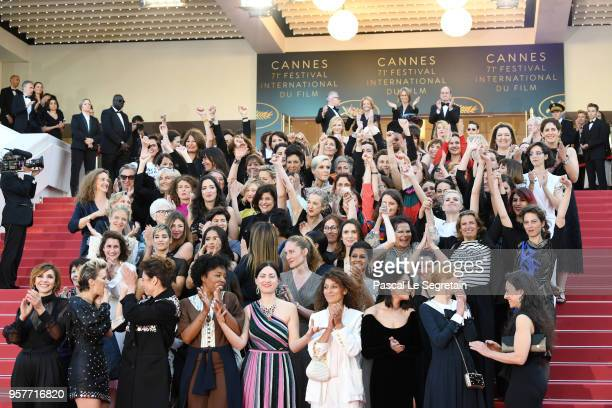 Filmmakers on the steps of the red carpet in protest of the lack of female filmmakers honored throughout the history of the festival at the screening...