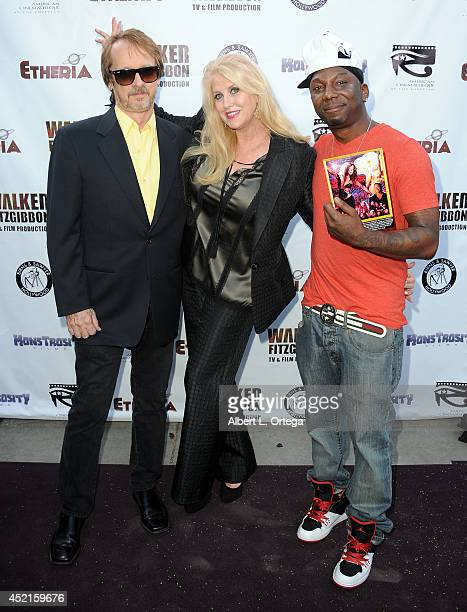 Filmmakers Robert W Walker RasKass and Mo Fitzgibbon arrive for the 2014 Etheria Film Night held at American Cinematheque's Egyptian Theatre on July...