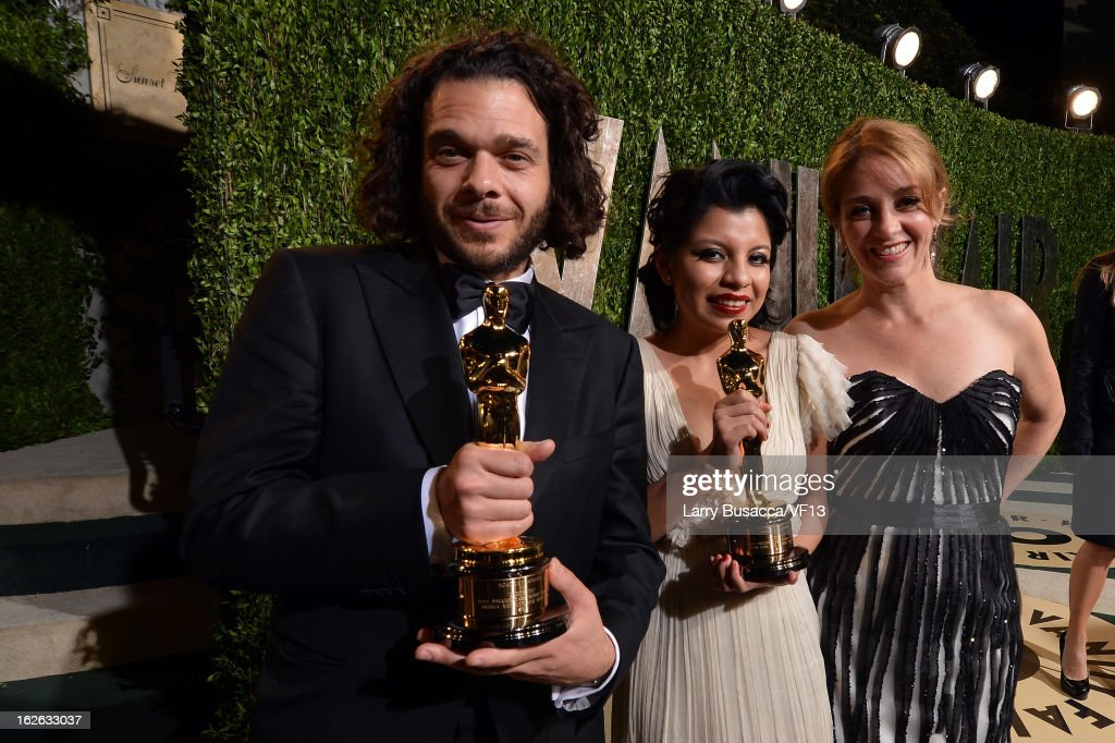 Filmmakers Sean Fine, artist Inocente Izucar, and Andrea Nix Fine arrive for the 2013 Vanity Fair Oscar Party hosted by Graydon Carter at Sunset Tower on February 24, 2013 in West Hollywood, California.