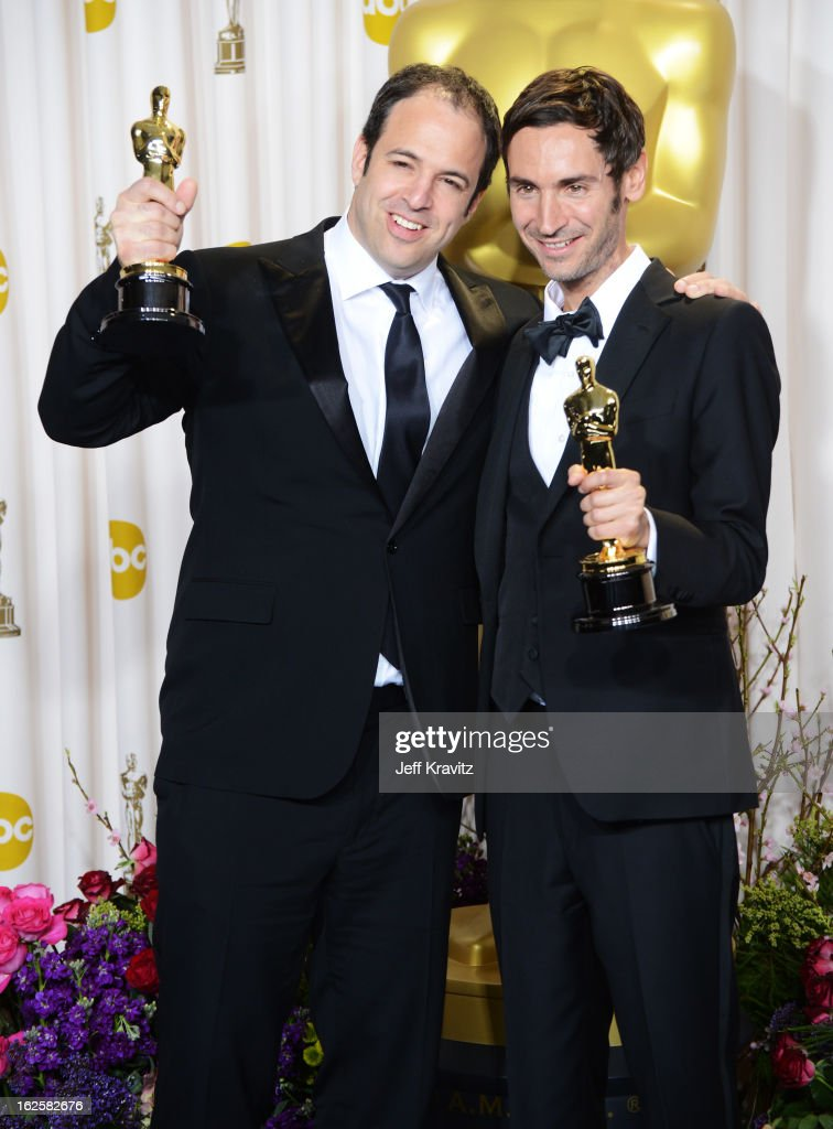 Filmmakers Simon Chinn (L) and Malik Bendjelloulposes in the press room during the Oscars at Loews Hollywood Hotel on February 24, 2013 in Hollywood, California.