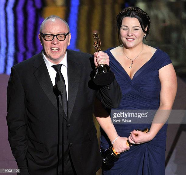 Filmmakers Terry George and Oorlagh George accept the Best Live Action Short Film Award for 'The Shore' onstage during the 84th Annual Academy Awards...