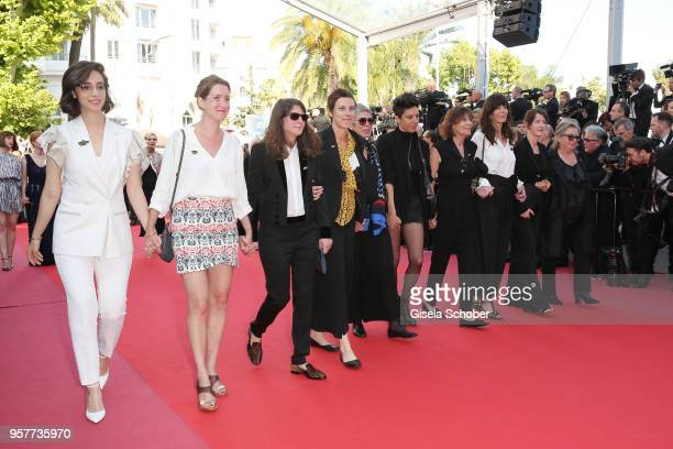 """Filmmakers walk the red carpet in protest of the lack of female filmmakers honored throughout the history of the festival at the screening of """"Girls..."""
