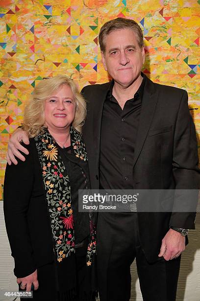 FilmRise President Jack Fisher with his wife Diana attend FilmRise Celebrates new office in Industry City Brooklyn at FilmRise on February 25 2015 in...