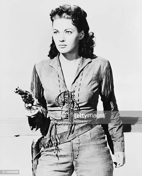 Filmy skirts gave way to leather breeches in Sam Bass and Calamity Jane Yvonne was taught to spin the cylinder and fan the hammer of a pistol like a...