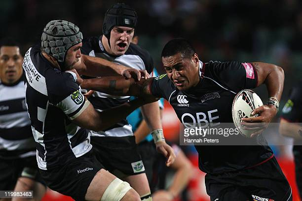 Filo Paulo of North Harbour fends off Brodie Retallick of Hawke's Bay during the round five ITM Cup match between North Harbour and Hawke's Bay at...
