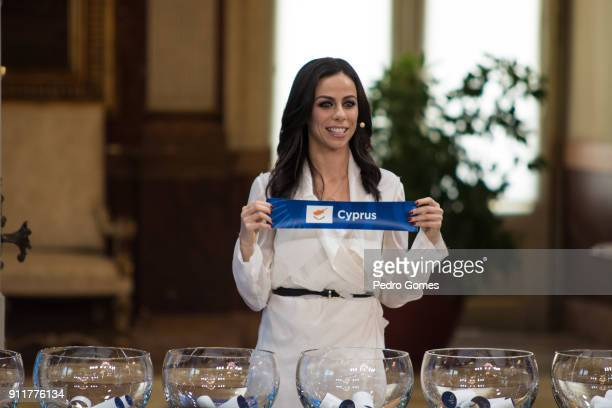 Filomena Cautela who will be part of the presenting team for Eurovision 2018 holds up the sign for Cyprus during the Eurovision semifinal allocation...