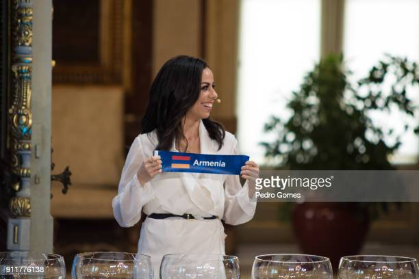Filomena Cautela who will be part of the presenting team for Eurovision 2018 holds up the sign for Armenia during the Eurovision semifinal allocation...
