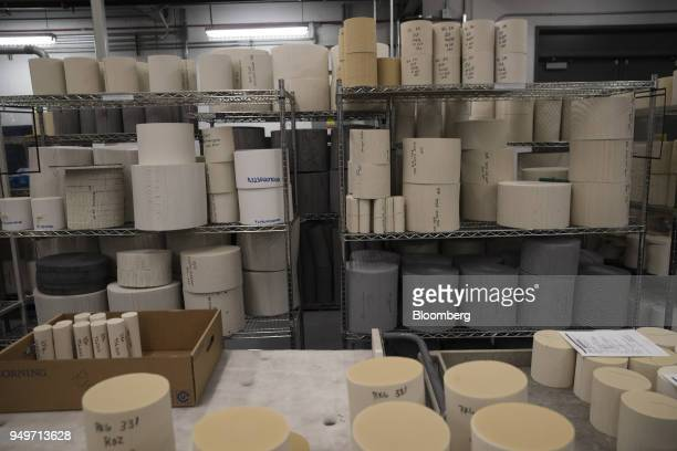 Filters for catalytic converters are stacked at the Corning Inc Sullivan Park Science Technology Center in Corning New York US on Tuesday March 28...