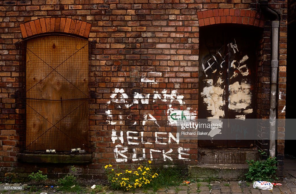 A filthy alleyway in Toxteth, Liverpool amid socially