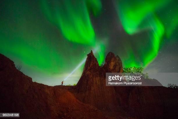 fin art - aurora norther light and torch man on a hill