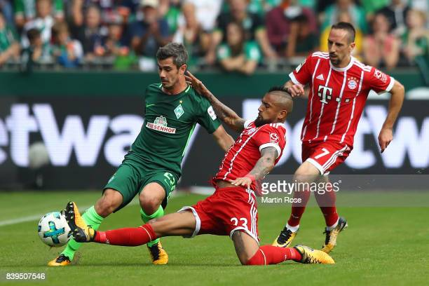 Fin Bartels of Bremen , Arturo Vidal of Bayern Muenchen and Franck Ribery of Bayern Muenchen fight for the ball during the Bundesliga match between...