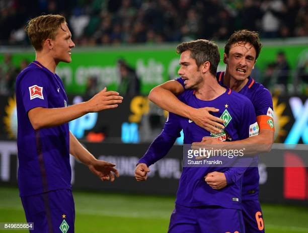 Fin Bartels of Bremen celebrates scoring his goal with Thomas Delaney during the Bundesliga match between VfL Wolfsburg and SV Werder Bremen at...