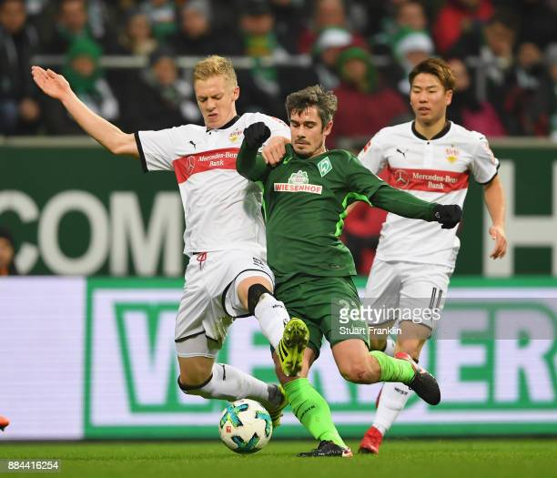 Fin Bartels of Bremen is challenged by Timo Baumgartl of Stuttgart during the Bundesliga match between SV Werder Bremen and VfB Stuttgart at...
