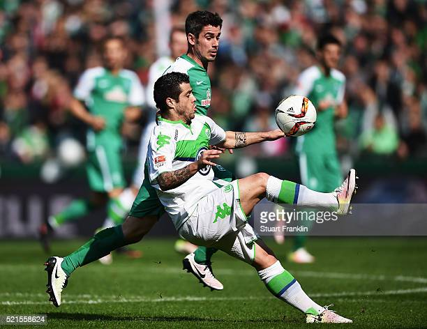 Fin Bartels of Bremen is challenged by Vierinha of Wolfsburg during the Bundesliga match between Werder Bremen and VfL Wolfsburg at Weserstadion on...