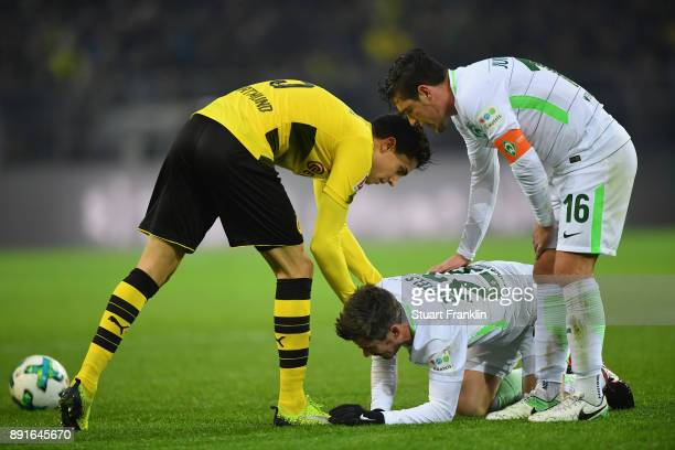 Fin Bartels of Bremen lays injured during the Bundesliga match between Borussia Dortmund and SV Werder Bremen at Signal Iduna Park on December 9 2017...