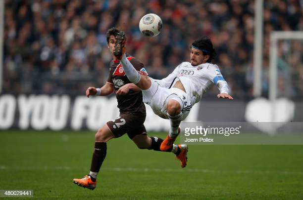 Fin Bartels of Hamburg and Almoq Cohen of Ingolstadt compete for the ball during the Second Bundesliga match between FC St. Pauli and FC Ingolstadt...