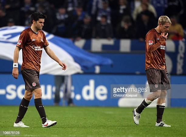 Fin Bartels of Pauli and Marius Ebbers of Pauli look dejected after losing 0-3 the Bundesliga match between FC Schalke 04 and FC St. Pauli at Veltins...
