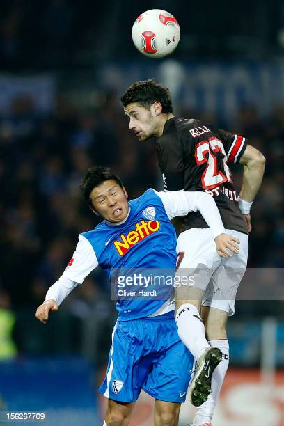 Fin Bartels of Pauli and Yusuke Tasaka of Bochum battle for the ball during the 2 Bundesliga match between FC St. Pauli and VfL Bochum at Millerntor...
