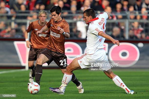 Fin Bartels of St. Pauli and Christian Eigler of Nuernberg battle for the ball during the Bundesliga match between FC St. Pauli and 1. FC Nuernberg...