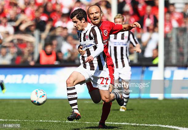 Fin Bartels of St. Pauli and Ivica Banovic of Cottbus battle for the ball during the Second Bundesliga match between St. Pauli and Energie Cottbus at...