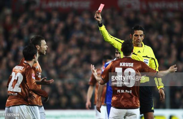 Fin Bartels of St. Pauli gets the red card from referee Deniz Aytekin during the Bundesliga match between FC St. Pauli and FC Schalke 04 at...