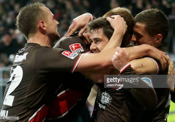 Fin Bartels of StPauli celebrates with his team mates after scoring his team's second goal during the Second Bundesliga match between FC St Pauli and...