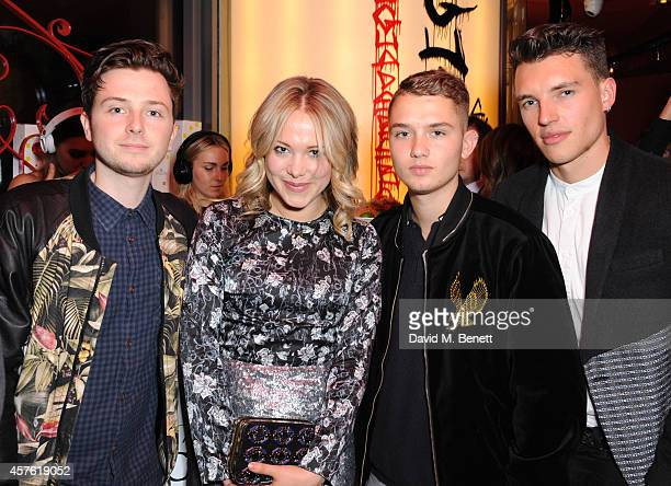 Fin Kemp Poppy Jamie Raffert Law and Max Cocking attend the 50th Anniversary of Champagne Jacquart at Sushi Samba on October 21 2014 in London England