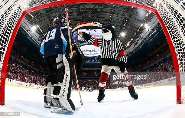 Fin the mascot of the Vancouver Canucks plays with a young goaltender between periods of the NHL game between the Vancouver Canucks and the Colorado...