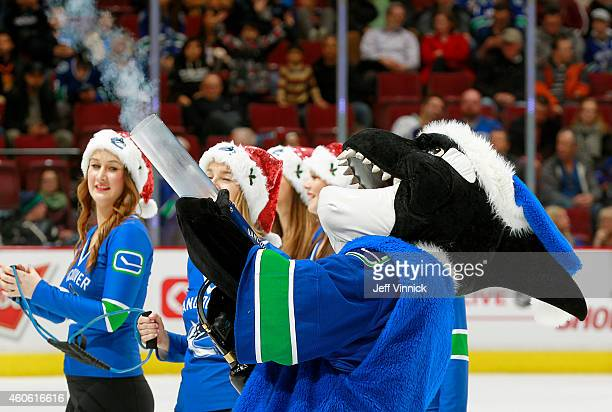 Fin the Vancouver Canucks' mascot fires Tshirts into the stands during the NHL game against the Dallas Stars at Rogers Arena December 17 2014 in...