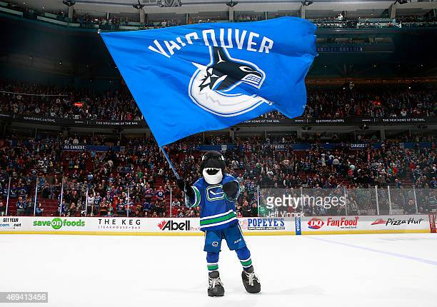 Fin the Vancouver Canucks' mascot salutes the fans after their game against the Edmonton Oilers at Rogers Arena April 11 2015 in Vancouver British...