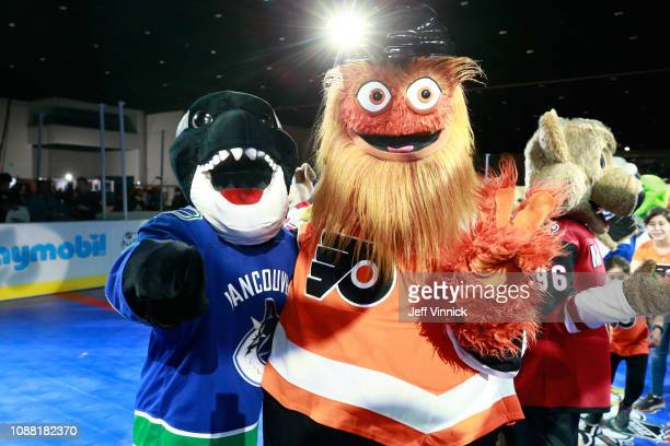 Fin the Whale of the Vancouver Canucks and Gritty of the Philadelphia Flyers participate in the 2019 NHL AllStar Mascot Showdown on January 24 2019...