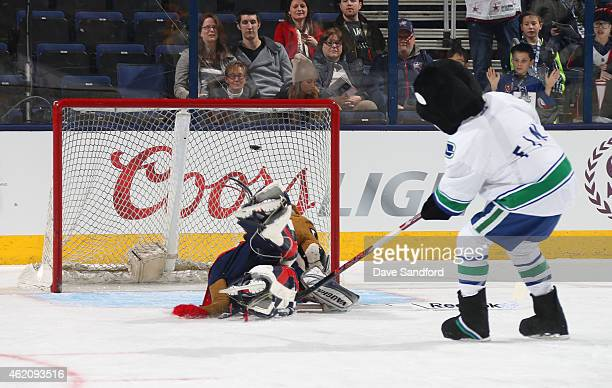 Fin the Whale of the Vancouver Canucks scores a goal during the mascot showdown as part of the 2015 NHL AllStar Weekend at Nationwide Arena on...