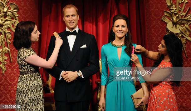 Final adjustments are made to the newly made over The Duke and Duchess of Cambridge waxworks before they go on display at Madame Tussauds on July 2...