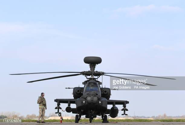 Final checks are carried out on an Apache helicopters on the flight line at Wattisham Airfield in Suffolk as they head to the Baltics for a...