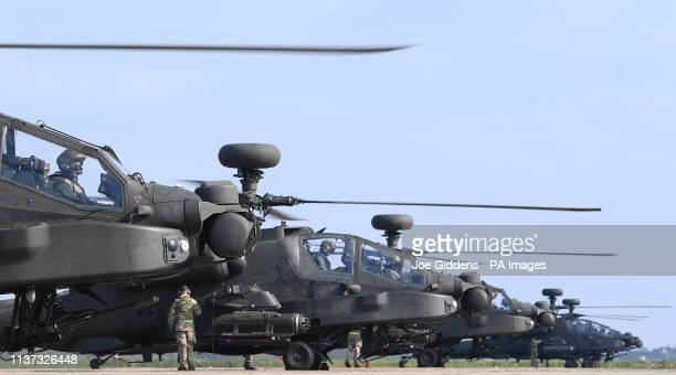 Final checks are carried out on five Apache helicopters on the flight line at Wattisham Airfield in Suffolk, as they head to the Baltics for a...