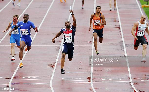 Final leg runner Mark LewisFrancis of Great Britain wins gold for his team during the Men's 4 x 100 Metres Relay Final on day seven of the 19th...