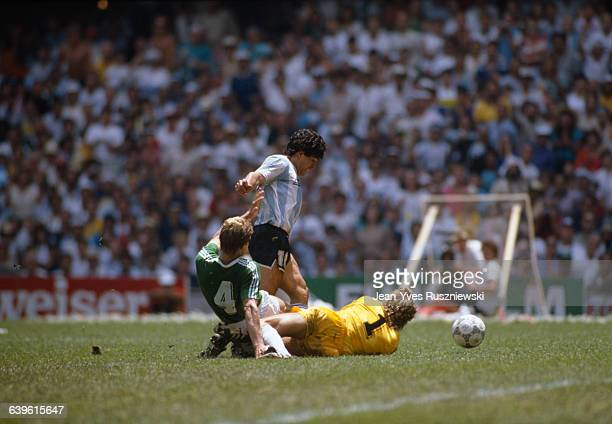 Final of the 1986 FIFA World Cup in the Azteca stadium Argentina vs Germany Argentina won 32 Argentina's Diego Maradona is tackled by Germany's...