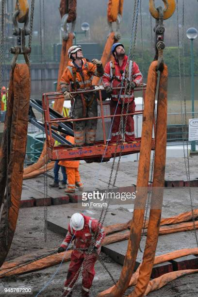 Final preparations are made as a replica of Captain Cook's famous ship HM Bark Endeavour is made ready to be hoisted by crane over the lock gates on...