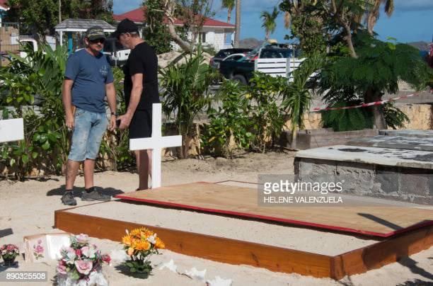 Final preparations are made on December 11 2017 at the cemetery in Lorient on the French Caribbean island of Saint Barthelemy where late French...