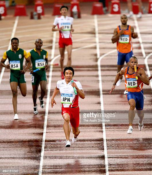 Final runner Nobuharu Asahara of Japan competes in the Men's 4 x 100m relay Heats at the National Stadium during Day 13 of the Beijing 2008 Olympic...