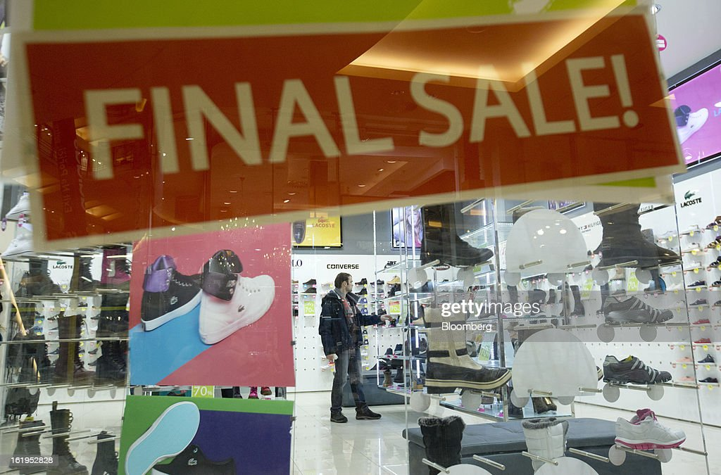 A Final Sale Sign Hangs In The Window Of An Office Shoe Store In Prague,