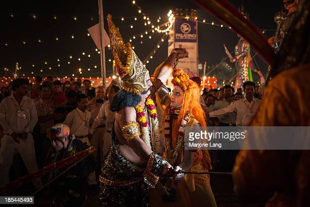 the battle between Ram and Ravan at Dussehra festival held near the Red Fort of old Delhi on 13th october 2013 Delhi India Dasara or Dussehra derived...