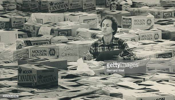 Final tally: Barry Davidson; manager of the Daily Bread food bank's warehouse on Pacific Ave.; may look like he's cleaning up after a big party; but...